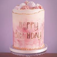 Watercolour buttercream cake with wave edge