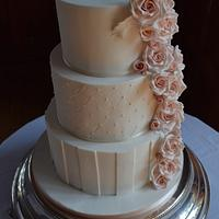Elegant wedding cake with cascading roses