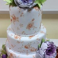 Lilac and rose gold wedding cake with peonies