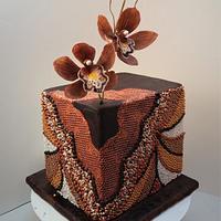 Beaded cake with chocolate cymbidium orchids