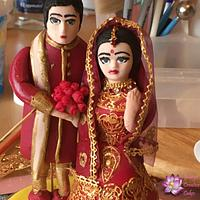 Indian style wedding cake topper