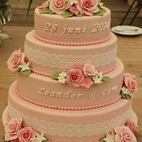 Vintage wedding cake with roses and lace