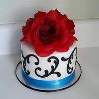 Black and white wedding cake with teal ribbon
