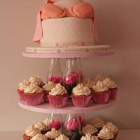 Baby rump cake with cupcakes on a bespoke stand