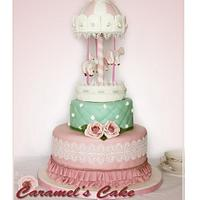 Carosel cake with roses and laces