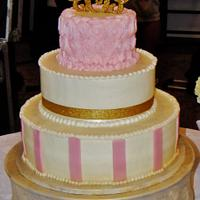 Pink rosette and stripe wedding cake