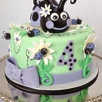 Pretty Purple Ladybug Birthday Cake