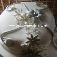 Silver Swirls. by debscakecreations