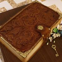 Tooled leather book cake