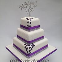 Purple tiered wedding cake