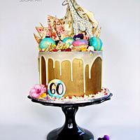 Gold giraffe drip cake