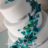 Teal coloured butterfly wedding cake