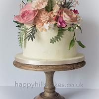 Corals, pinks and foliage natural wedding cake