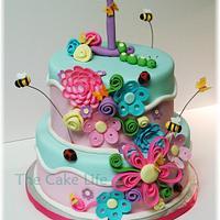 flower and bug 1st birthday cake