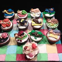 Cupcake babies on a quilted blanket