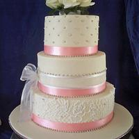 pink and white lace wedding cake