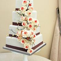 Roses and blossom branches wedding cake
