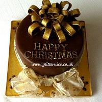 Chocolate Christmas Cake with gold ribbons
