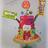 """Gravity defying """"ICING SMILES"""" candy shop cake"""