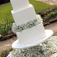 Simple square white wedding cake