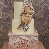 Wedding cake with fabric flowers and draping