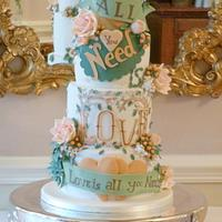 Autumnal 'all you need is love' wedding cake.