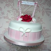 Pink, white & red 80th birthday cake
