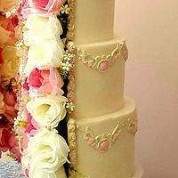 Split rose and pearl wedding cake