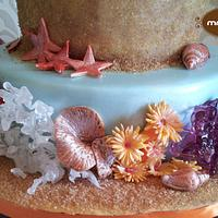 Beach and coral reef wedding cake