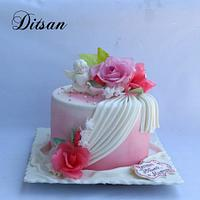 Pink cake with waffle flowers