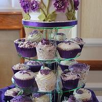 Purple peony topcake and purple cupcakes