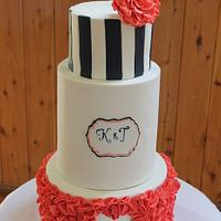 Coral, navy and white wedding cake