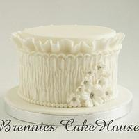 romantic cake with smock fabric and ruffles