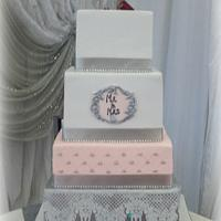 Salmon, white and silver wedding cake