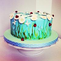 Ladybugs and daisy flowers cake