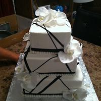 Ribbon with Orchids Wedding Cake