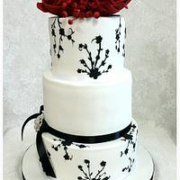 White and Black cake with red Roses
