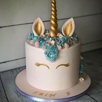 Pastel pink and blue unicorn cake