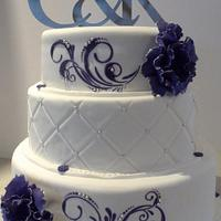 purple and silver themed engagement cake