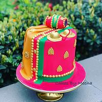 Saree, kartal and dholak cake