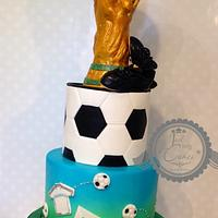 Soccer cake with trophy