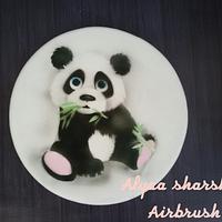 Airbrushing panda on fondant