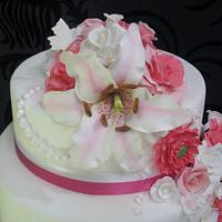 pink and white floral wedding cake by dazzleliciouscakes