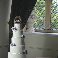 Penguins, lace and roses wedding cake