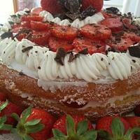 cake with dark chocolate, fresh strawberries and whipped cream