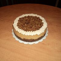 Pumpkin cheesecake w/pecan praline topping & cinnamon whipped cream