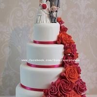Bright pink and orange rose wedding cake