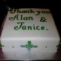 White and Green Retirement Cake