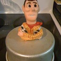 """Toy Story birthday featuring """"Woody"""" ripping through top tier by CakesbyDeb"""