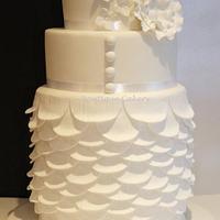 White wedding cake based on Justin Alexander dress